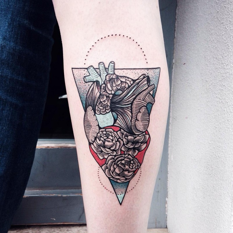 Ornamental style colored arm tattoo of human heart with flowers