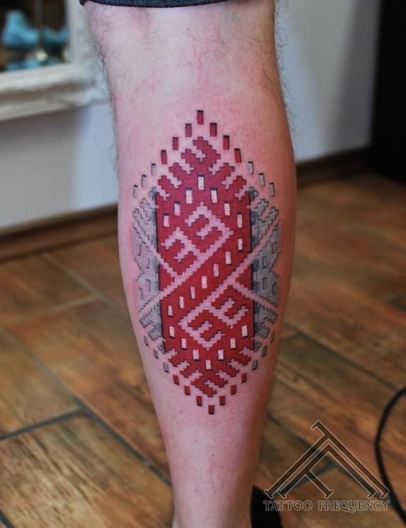 Ornamental style colored leg tattoo of big beautiful picture