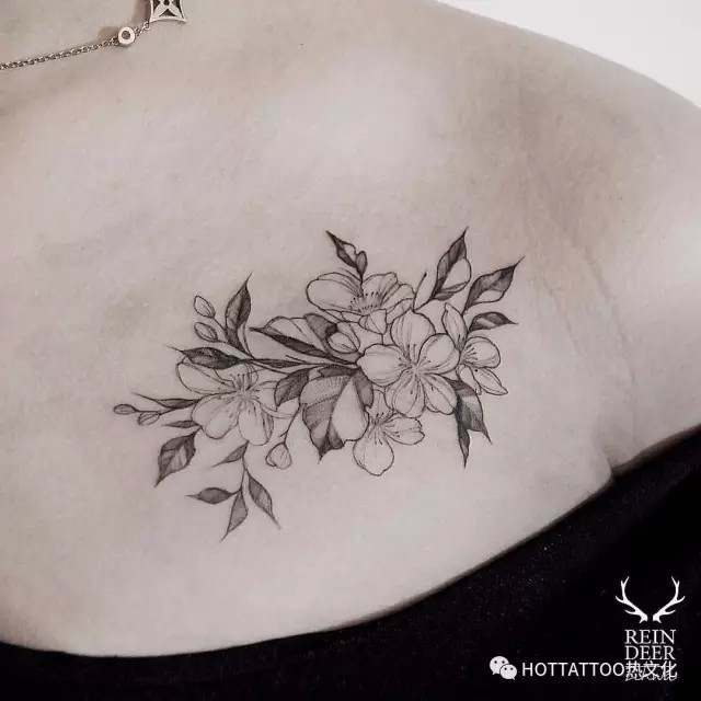 Outline style black ink chest tattoo of cute flowers by Zihwa