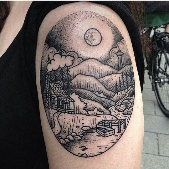 Oval shaped black ink shoulder tattoo of night tree with mountains
