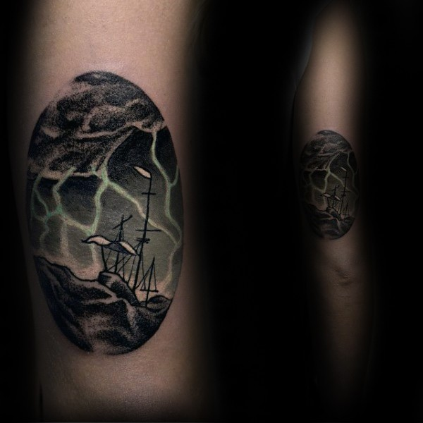 Oval shaped colored sailing ship in stormy sea tattoo