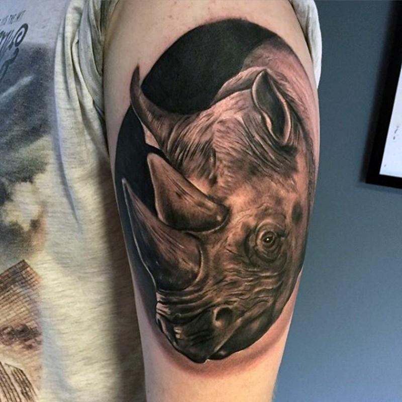 Oval shaped rhinoceros 3D realistic lifelike photo wildlife tattoo on shoulder