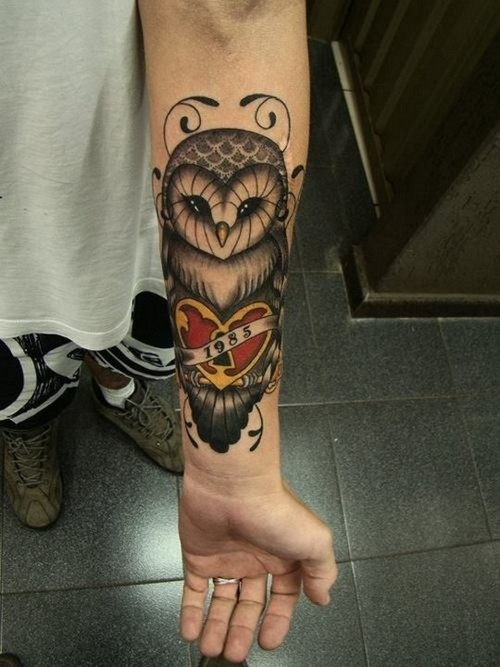 Owl and heart with a lock forearm tattoo