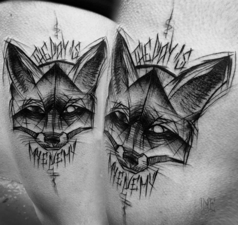 Painted by Inez Janiak blackwork style thigh tattoo of fox with lettering