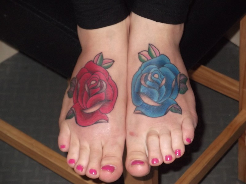 Painted cute rose tattoo on both feet