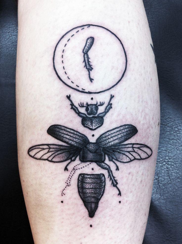 Part of beetle black ink tattoo on leg
