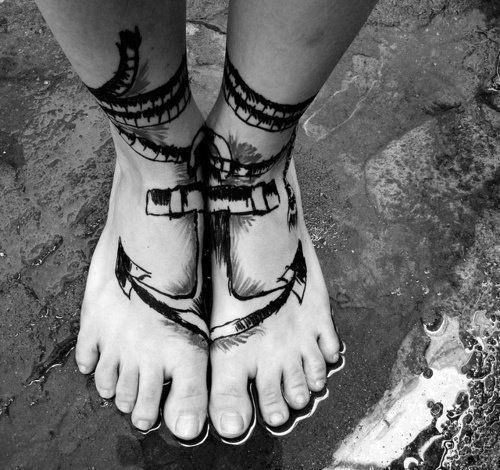 Parted sharp roped anchor tattoo on both foot