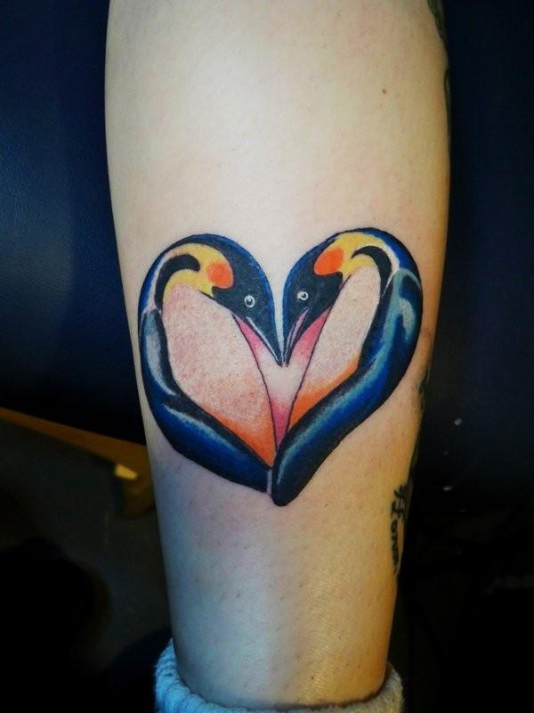 Penguin heart tattoo on leg