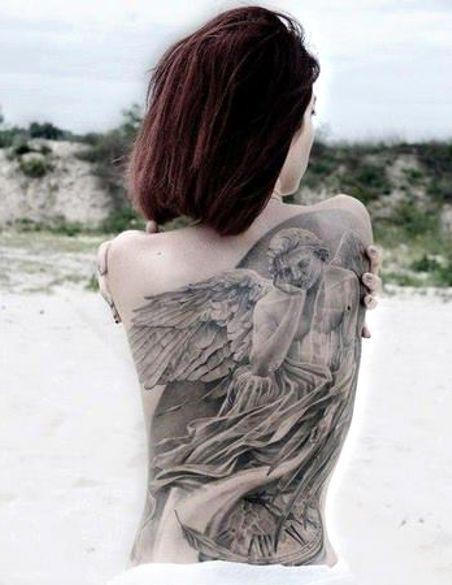 Pensive angel and watch tattoo on back
