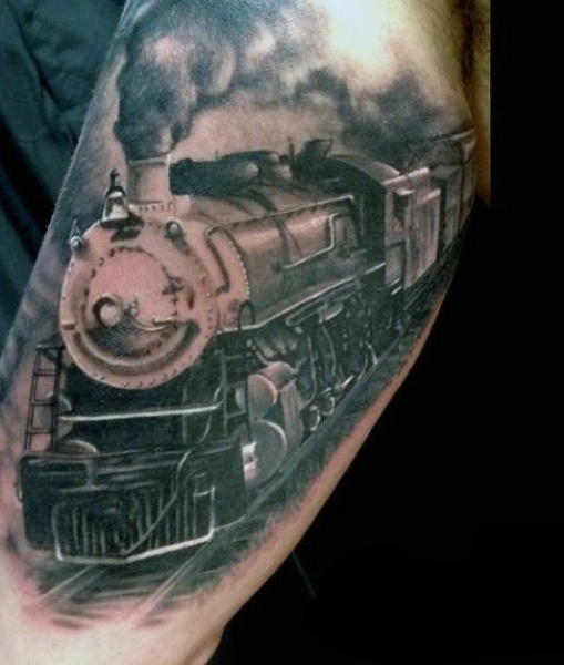 Photo like detailed biceps tattoo of vintage steam train
