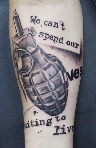 Photoshop style black and white military grenade tattoo on forearm combined with lettering