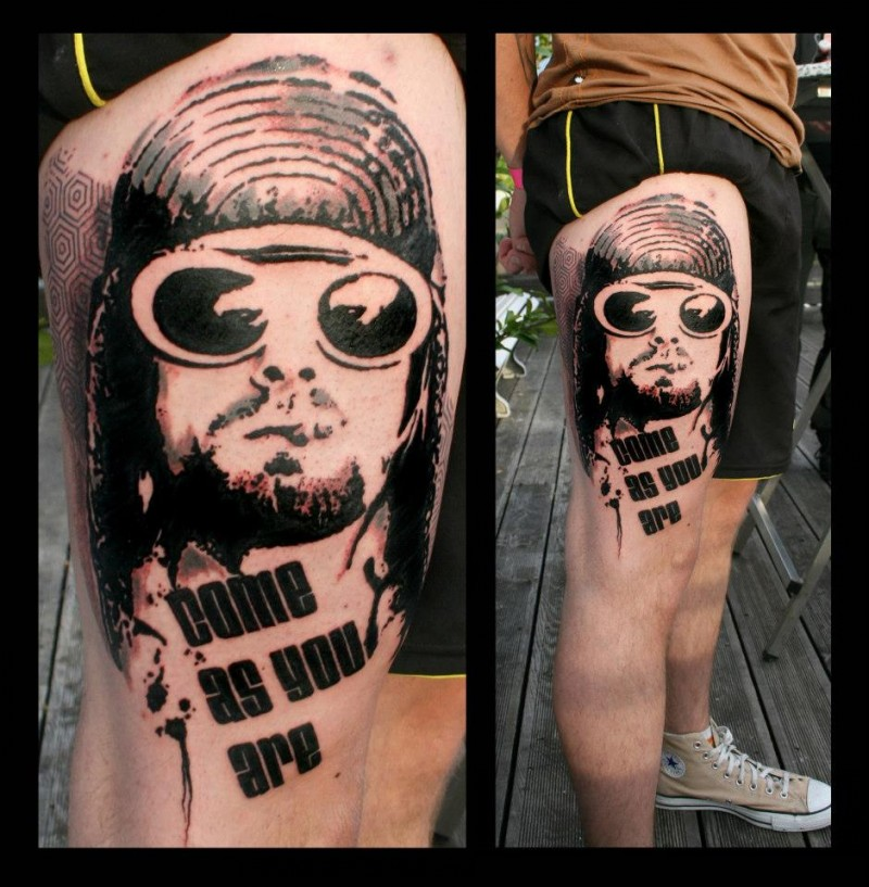 Photoshop style black ink thigh tattoo of smoking man in sun glasses with lettering