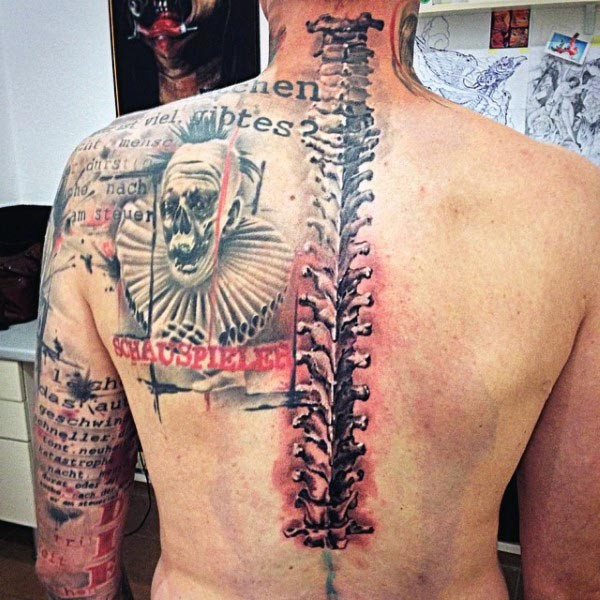 Photoshop style colored back and shoulder tattoo of spine bones, clown and lettering