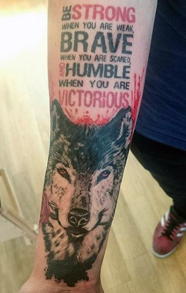 Photoshop style colored forearm tattoo of wolf head with lettering