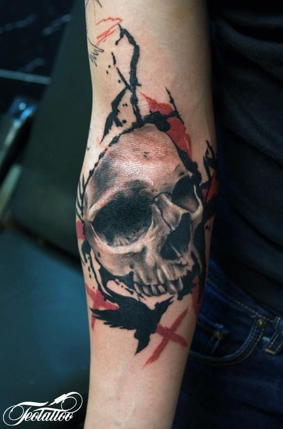 Photoshop style colored forearm tattoo of human skull with black crow