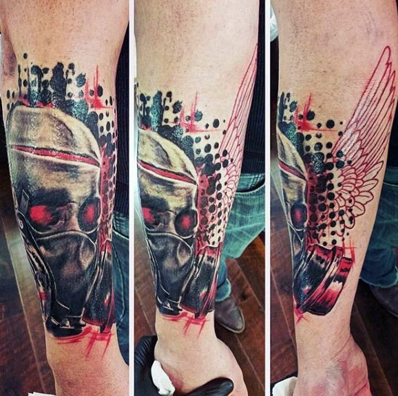 Photoshop style colored forearm tattoo of demonic skull with wings