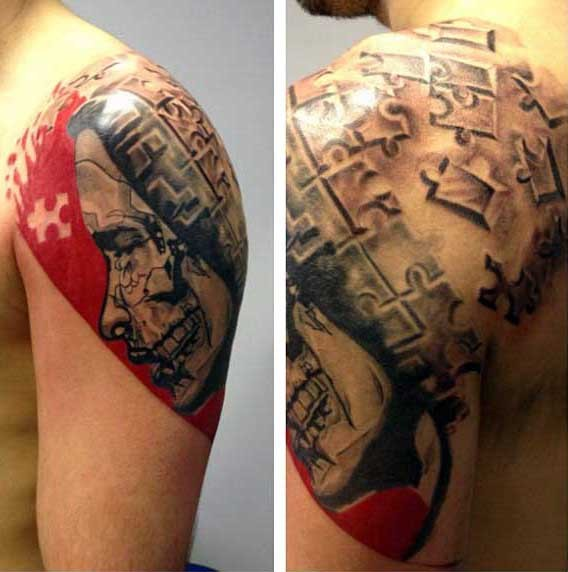 Photoshop style colored puzzle like man face tattoo on shoulder