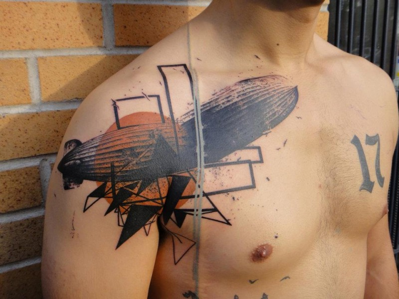 Photoshop style colored shoulder and chest tattoo of air ship