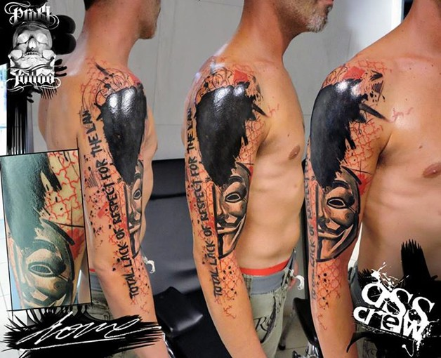 Photoshop style colored shoulder tattoo of Anonymous mask and lettering