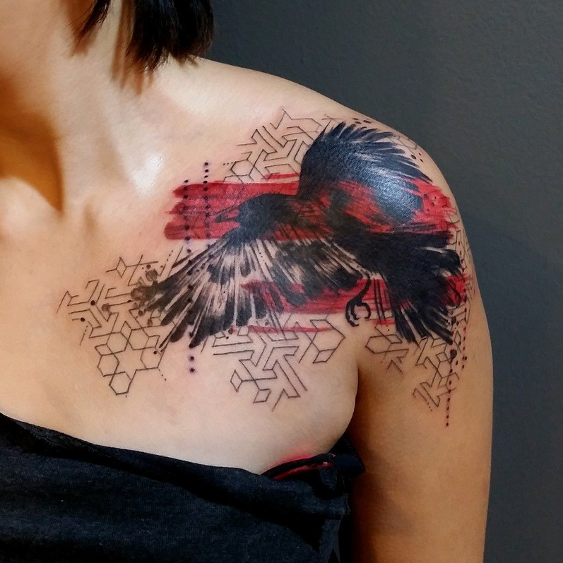 Photoshop style colored shoulder tattoo of flying bird