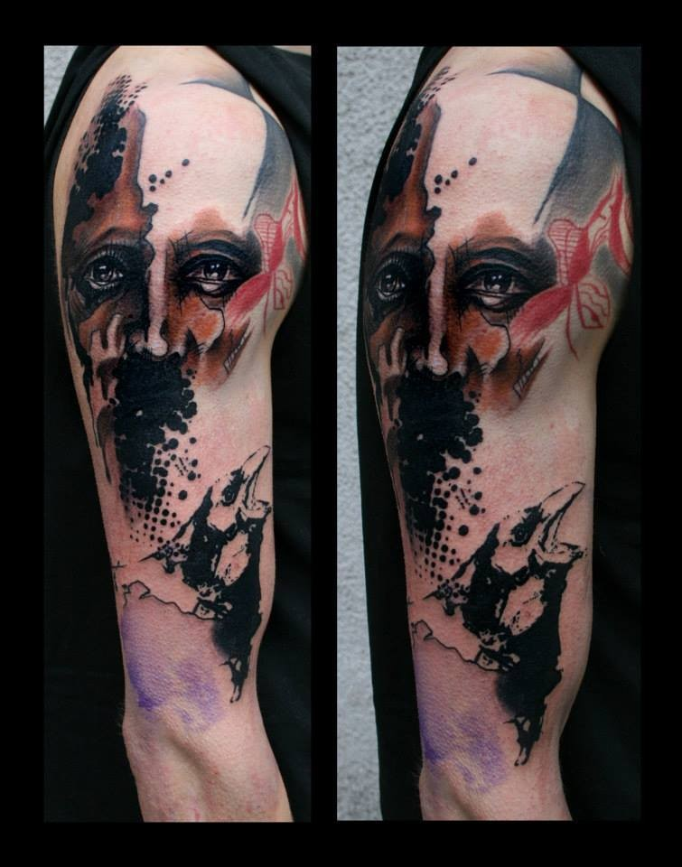 Photoshop style colored shoulder tattoo of man portrait with crow