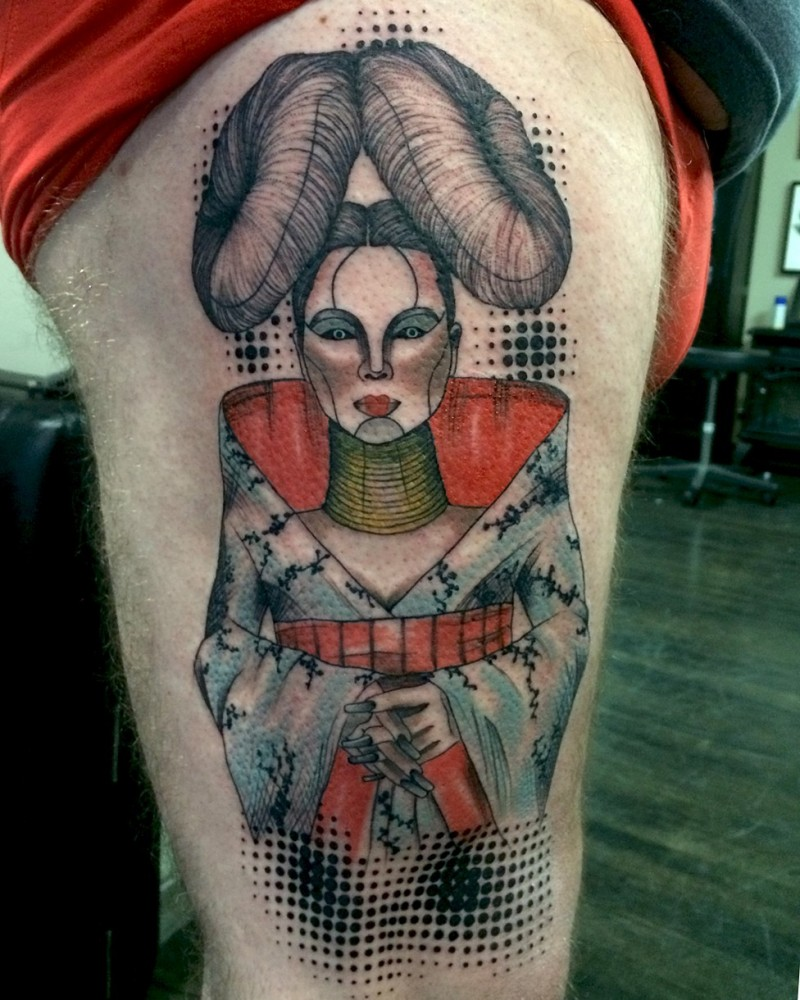 Photoshop style colored thigh tattoo of creepy looking geisha