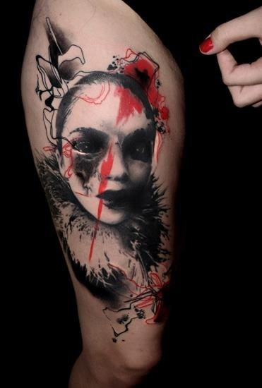 Photoshop style colored thigh tattoo of creepy woman mask
