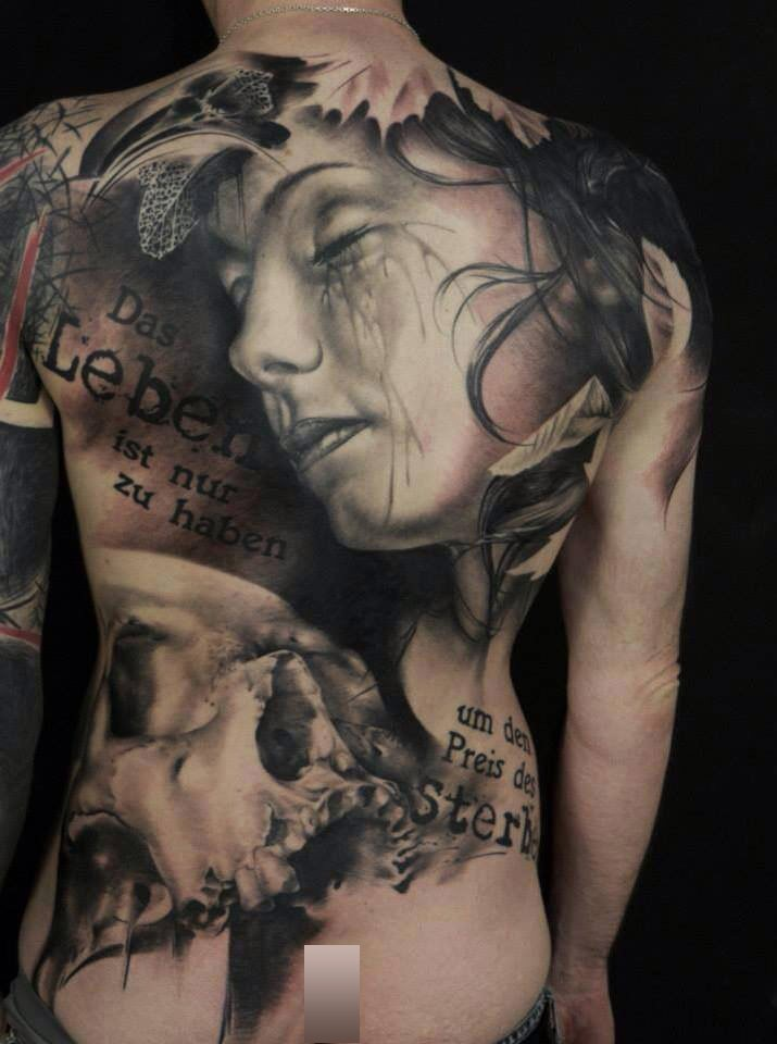 Photoshop style colored whole back tattoo of sleeping woman with skull and lettering