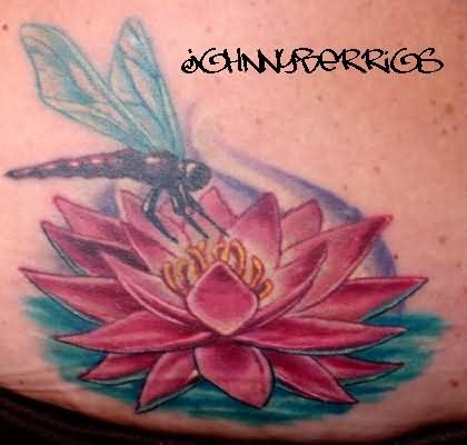 Pink lotus and dragonfly tattoo