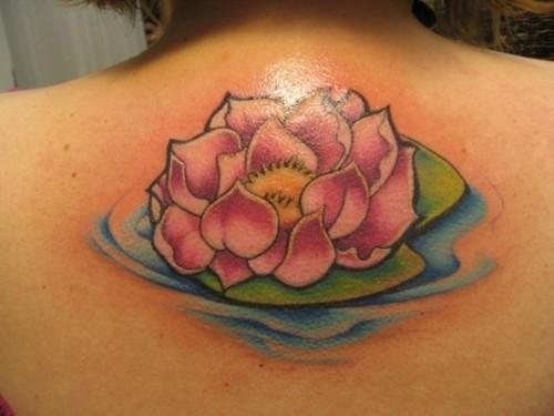 Pink lotus on water tattoo