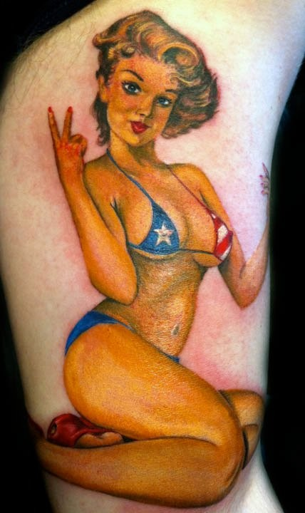Pinup girl in bikini colors of american flag tattoo