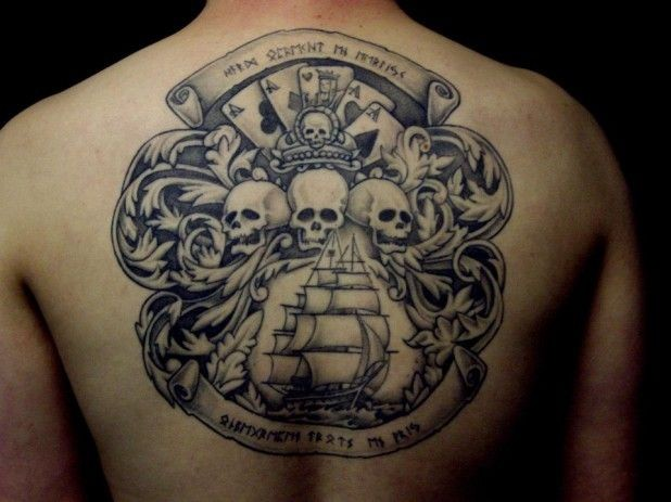 Pirate flag with cards skulls and ship tattoo