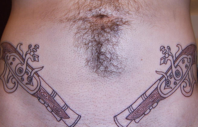Pirate muskets lower belly tattoo