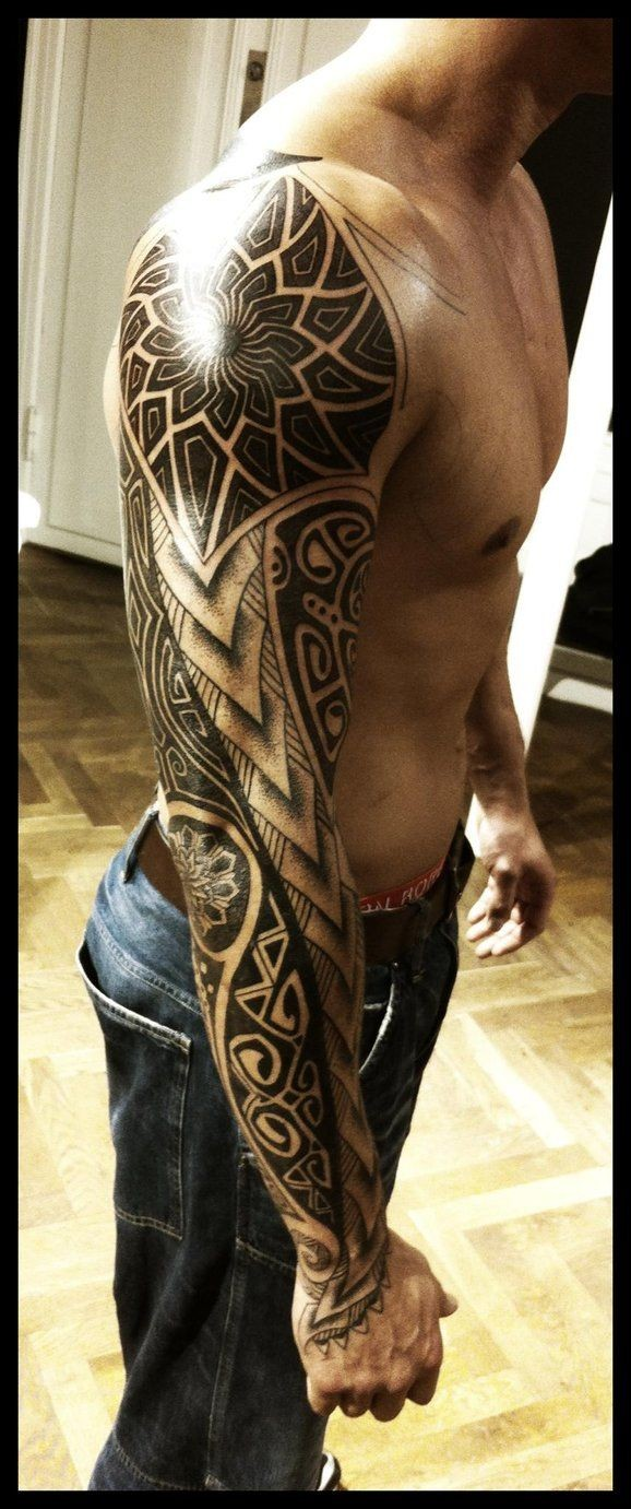 Polynesian style black and white detailed ornaments tattoo on sleeve
