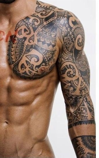 Polynesian style black and white massive tattoo on shoulder and chest