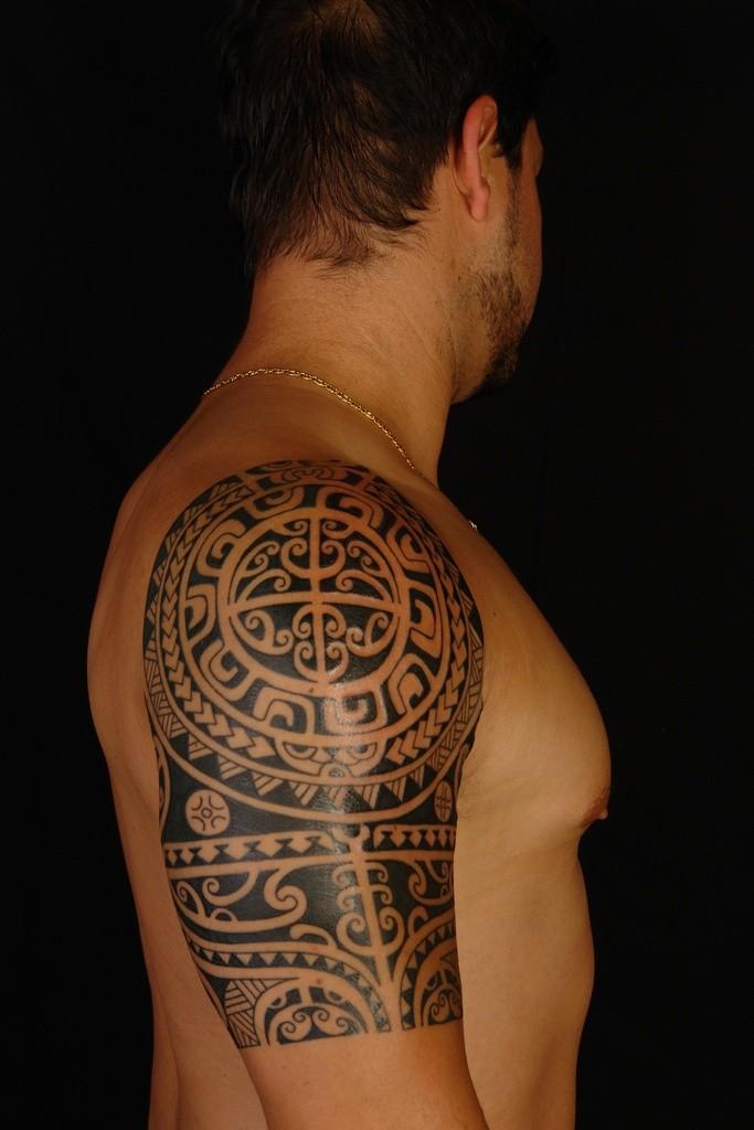 Polynesian style massive black ink ornaments tattoo on shoulder