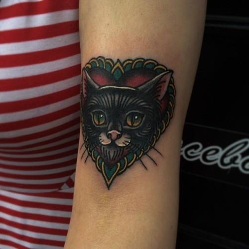 Portrait of a black cat tattoo by Iain Sellar