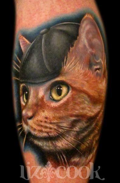 Portrait of a cat wearing a cap tattoo by Liz Cook