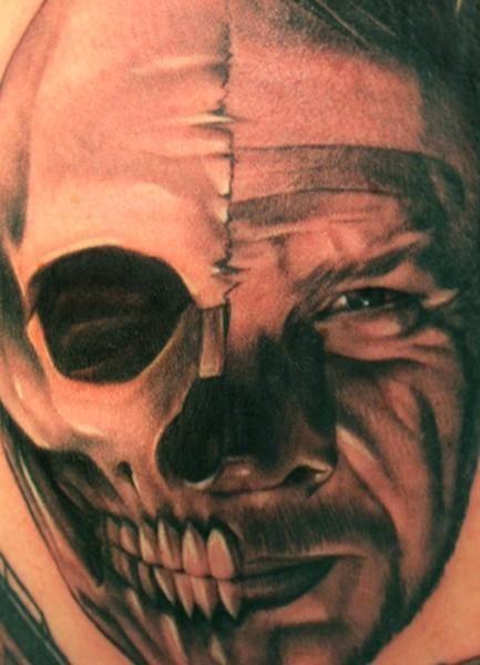 Portrait of half skull half man tattoo