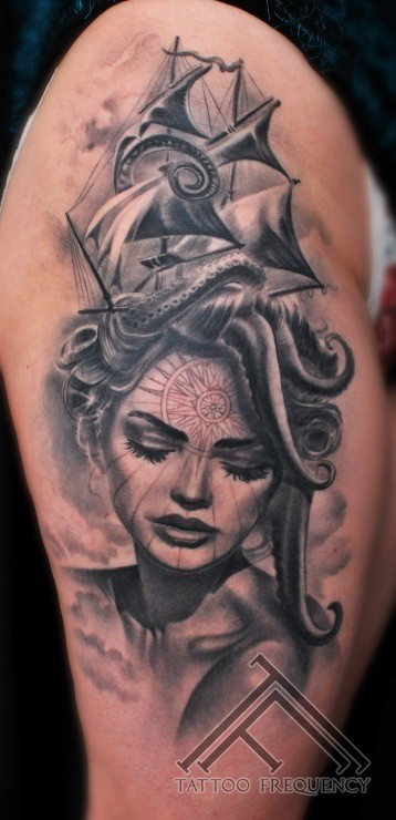 Portrait style black and white thigh tattoo of woman portrait and sailing ship
