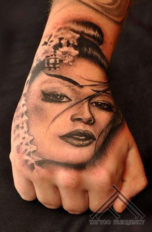 Portrait style black ink hand tattoo of Japanese geisha
