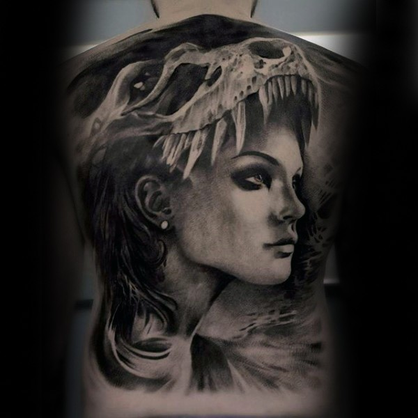 Portrait style black ink whole back tattoo of woman face with dinosaur skull