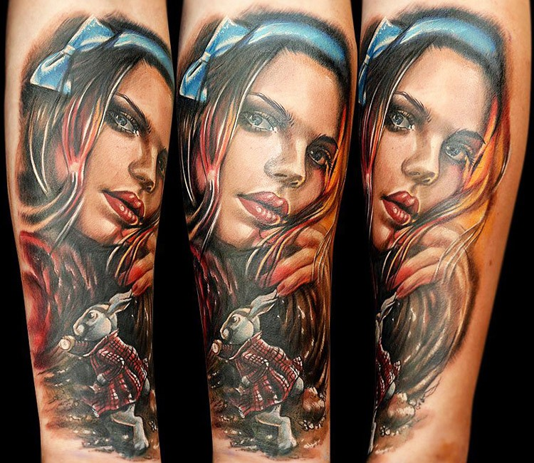 Portrait style colored arm tattoo of beautiful woman with rabbit