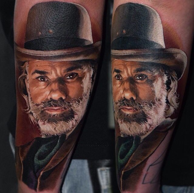 Portrait style colored arm tattoo of vintage man face with beard