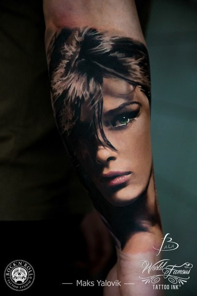 Portrait style colored arm tattoo of beautiful woman