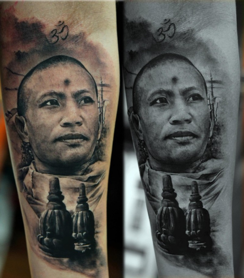 Portrait style colored arm tattoo of Asian man face