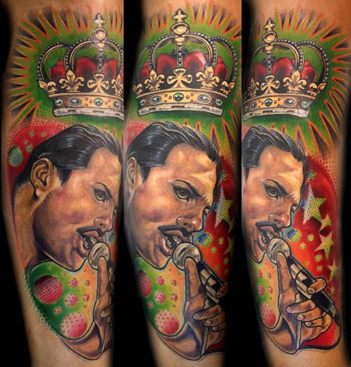 Portrait style colored arm tattoo of Queen with crown
