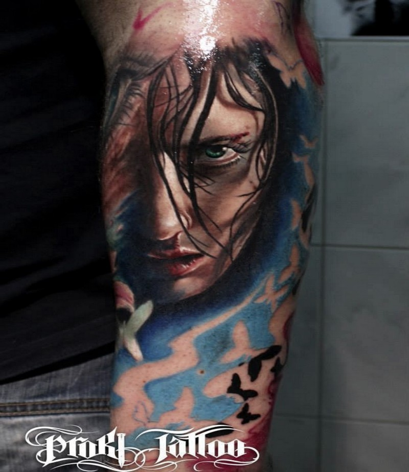 Portrait style colored arm tattoo of scary woman with butterflies