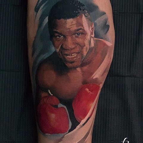 Portrait style colored arm tattoo of young Mike Tyson