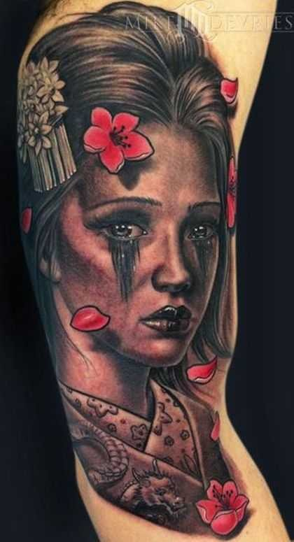 Portrait style colored biceps tattoo of Asian geisha